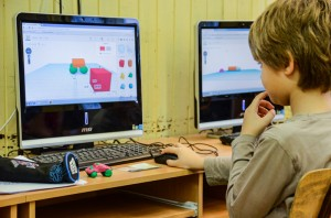 A boy models basic shapes with Tinkercad.
