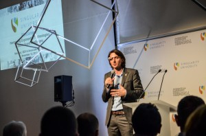 CEO of Singularity University Rob Nail, wearing his Google Glass, speaks at Design Terminál in Budapest.